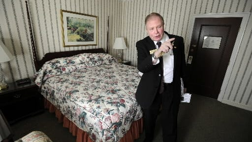 Rick Cunningham, general manager of the Yorktowne Hotel, shows off one of the hotel's guest rooms in this photo from 2012.