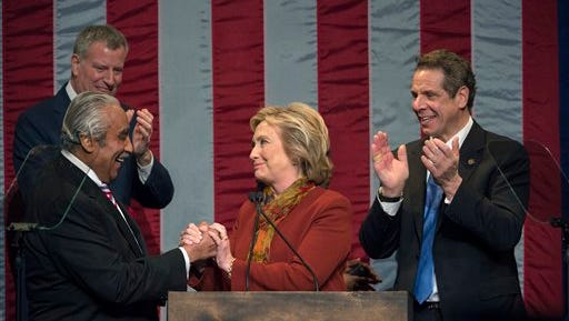 New York Mayor Bill de Blasio, left and Gov. Andrew Cuomo, right watch as Democratic presidential candidate Hillary Clinton, center shakes hands with Rep. Charles Rangel, Feb. 16, 2016, in New York.