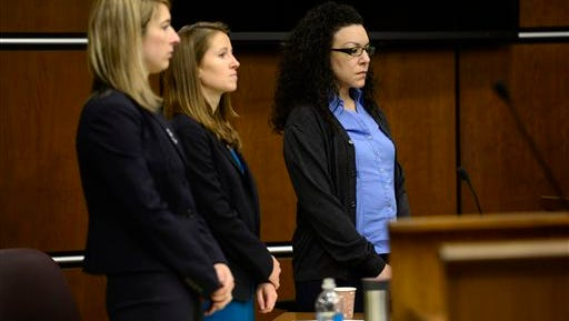 From left, Defense attorneys Kathryn Herold and Jen Beck stand with Dynel Lane as the jury enters the courtroom before closing statements in Boulder, Colo., on Monday, Feb. 22, 2016. Lane is charged with attempted murder, unlawful termination of a pregnancy and four counts of felony assault. (Matthew Jonas/Daily Camera via AP) NO SALES; MANDATORY CREDIT