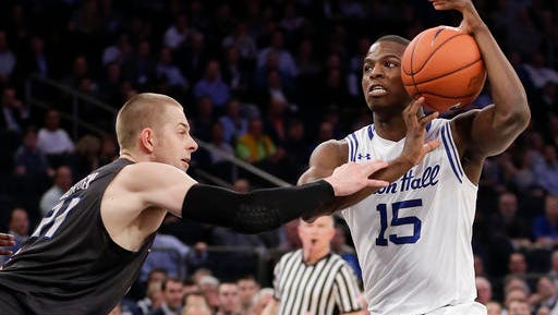 Creighton guard Isaiah Zierden (21) tries to strip the ball from Seton Hall guard Isaiah Whitehead (15) in the first half of an NCAA college basketball game during the Big East men's tournament, Thursday, March 10, 2016, in New York. (AP Photo/Julie Jacobson)