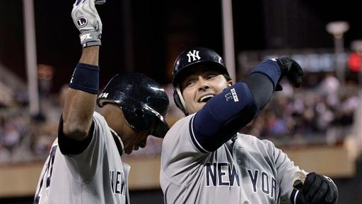 New York Yankees' Curtis Granderson, left, and Nick Swisher celebrate Swisher's two-run home run off Minnesota Twins pitcher Esmerling Vasquez in the fourth inning of a baseball game Tuesday, Sept. 25, 2012, in Minneapolis.