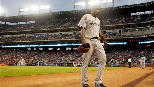 New York Yankees' Luis Severino walks to the dugout after pitching the first inning of a baseball game against the Texas Rangers on Tuesday, April 26, 2016, in Arlington, Texas. (AP Photo/Tony Gutierrez)