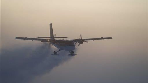 In this 2003 photo, provided by the National Science Foundation, a Twin Otter flies out of the South Pole on a previous medical flight. A daring South Pole medical rescue is underway. An airplane left a British base in Antarctica Tuesday, June 21, 2016, for the 1,500-mile trip to evacuate a sick person from the U.S. station. Athena Dinar, spokeswoman for the British Antarctic Survey, said one of two twin otter planes began the trip Tuesday, while the other is still at the Rothera station on the Antarctic Peninsula just in case.