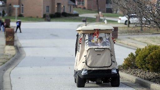 In this file photo, a golf cart is seen in a Henderson subdivision.