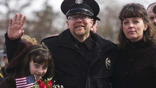 In this file photo, Eastern Adams Regional Police officer Rick Phillips waves to a crowd of supporters alongside his step-daughter, Brianna Milliken, then 12, left, and wife April, after arriving at the York Airport in Thomasville in February 2011 from a rehabilitation center in North Carolina.