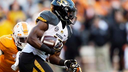 Missouri running back Damarea Crockett (16) runs for yardage as he's chased by Tennessee defensive back Rashaan Gaulden (7) during the first half of an NCAA college football game Saturday, Nov. 19, 2016, in Knoxville, Tenn. (AP Photo/Wade Payne)