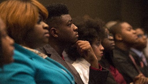 "December 10, 2016 - Myles Franklin, 17, and others listen during a ""Pitch Night"" event led by the organization Let's Innovate Through Education (LITE) at Memphis Bioworks Foundation. Twenty-five students made speed pitches in booths and eight finalists gave presentations to an audience who voted to decide which student would receive a cash prize to go toward realizing their idea."