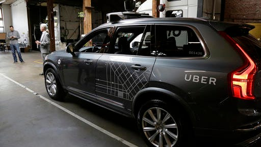 In this photo taken Tuesday, Dec. 13, 2016, an Uber driverless car is displayed in a garage in San Francisco. Uber is bringing a small number of self-driving cars to its ride-hailing service in San Francisco - a move likely to both excite the city's tech-savvy population and spark a conflict with California regulators. The Wednesday, Dec. 14, launch in Uber's hometown expands a public pilot program the company started in Pittsburgh in September.