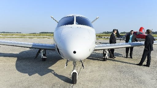 """On May 6, 2015, Cirrus Aircraft officials visited McGhee Tyson Airport to talk about their new SF50 Vision Jet, seen here, and plans to build a $15 million """"Vision Center"""" at the airport."""