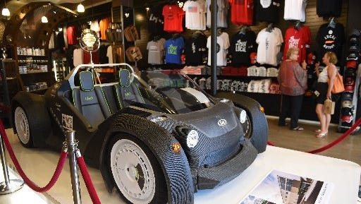 Customers check out merchandise, including a 3-D printed car, at Local Motors' Market Square retail store on April 29, 2016.