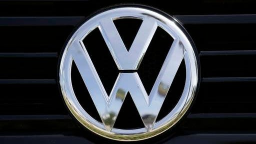 FILE - In this Sept. 21, 2015, file photo, a Volkswagen logo is seen on car offered for sale at New Century Volkswagen dealership in Glendale, Calif. The Volkswagen executive, Oliver Schmidt, who once was in charge of complying with U.S. emissions regulations has been arrested in connection with the company's emissions-cheating scandal, a person briefed on the matter said Monday, Jan. 9, 2017.