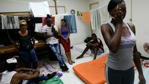 """Cuban migrant Yarisel Isac Wilson, 20, right, cries as she talks about her journey to the U.S. at a migrant shelter in Panama City, Thursday, Jan. 12, 2017. President Barack Obama announced Thursday he is ending a longstanding immigration policy that allows any Cuban who makes it to U.S. soil to stay and become a legal resident. The repeal of the """"wet foot, dry foot"""" policy is effective immediately."""