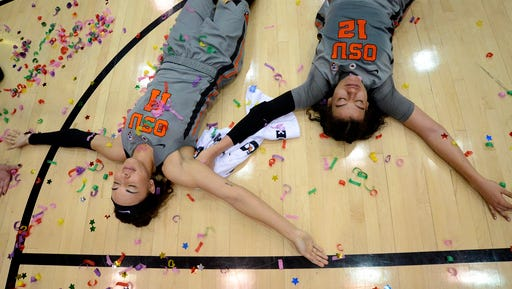 Oregon State's Gabriella Hanson (11) and Kolbie Orum (12) lay on the court after their NCAA college basketball game win over California on Sunday, Feb. 26, 2017.
