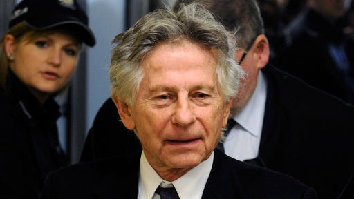 FILE - This Feb. 25, 2015 file photo shows filmmaker Roman Polanski during a break in a hearing concerning a U.S. request for his extradition over 1977 charges of sex with a minor, in Krakow, Poland. Los Angeles prosecutors on Wednesday, March 1, 2017, urged a judge to reject Polanski's efforts to unseal sworn testimony in his 1977 unlawful sex with a minor case, arguing the fugitive director must return to a Los Angeles court before his request can be considered.