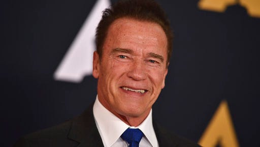 FILE - In this Nov. 12, 2016, file photo, Arnold Schwarzenegger arrives at the 2016 Governors Awards in Los Angeles. Schwarzenegger turned the table on President Donald Trump by taking to social media on March 21, 2017, to criticize Trump's approval rating.