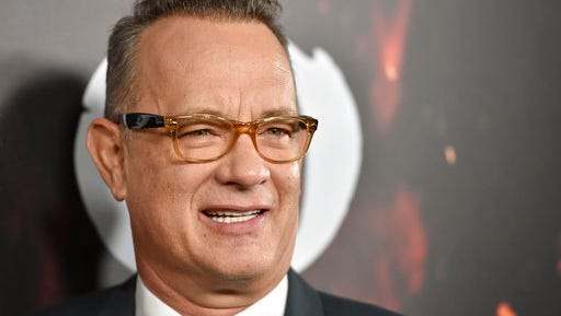 """FILE - In this Oct. 25, 2016, file photo, Tom Hanks arrives at a special screening of """"Inferno"""" at the Directors Guild of America Theatre in Los Angeles. Hanks is among the celebrities set to appear during a Facebook Live fundraiser for the ACLU that will stream on March 31, 2017."""