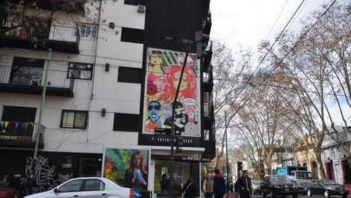 This July 23, 2015 photo shows a street in the Palermo Soho area of Buenos Aires, Argentina. The neighborhood has a smaller scale and a calmer vibe than the city's downtown and is a good place for visitors to shop, dine and stroll.