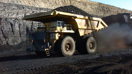 FILE - In this Nov. 15, 2016 file photo, a haul truck with a 250-ton capacity carries coal from the Spring Creek strip mine near Decker, Mont. President Trump's latest move to support coal mining is unlikely to turn around the industry's prospects immediately. Experts say the biggest problem faced by the mining industry today isn't a coal shortage of coal or even the prospect of climate change regulations, but an abundance of cheap natural gas.