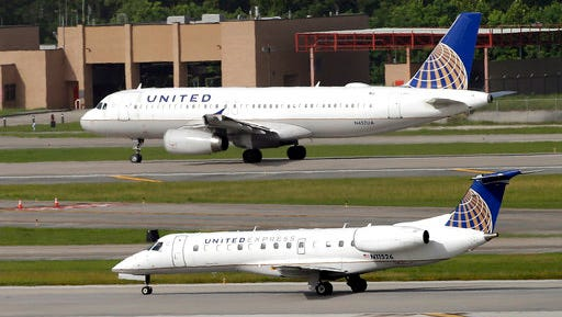 In this July 2015 file photo, United Airlines and United Express planes prepare to takeoff at George Bush Intercontinental Airport in Houston. After a man is dragged off a United Express flight April 9, United Airlines becomes the butt of jokes online and on late-night TV. Travel and public-relations experts say United has fumbled the situation from the start.