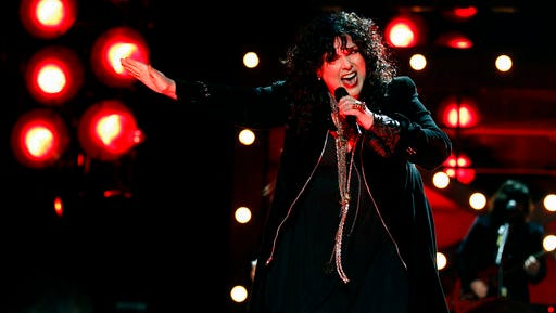 """FILE - In this Dec. 3, 2010, file photo, Ann Wilson of the band Heart performs onstage at the """"Vh1 Divas Salute the Troops"""" on in San Diego, Calif. The husband of Heart lead singer Ann Wilson has been sentenced for allegedly choking her nephews during a concert in suburban Seattle. Seattlepi.com reported Friday, April 14, 2017, that Dean Wetter pleaded guilty March 9 to two counts of assault. He was sentenced as part of a plea deal to 364 days in jail, with all the time suspended."""