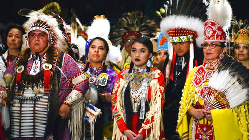 Native American dancers from the United States and Canada take part in the grand entry to the Gathering of Nations on Friday, April 28, 2017 in Albuquerque, N.M. The Gathering of Nations, one of North America's most prominent American Indian powwows, is attracting thousands of dancers and as many as 100,000 attendees to New Mexico's largest city this week.