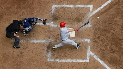 Cincinnati Reds' Scott Schebler hits a home run during the fourth inning of a baseball game against the Milwaukee Brewers Wednesday, April 26, 2017, in Milwaukee. (AP Photo/Morry Gash)