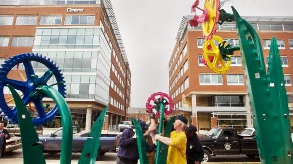 Ten metal flower sculptures made from old industrial