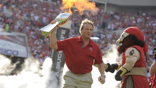 Former Tampa Bay Buccaneers head coach Jon Gruden walks onto the field as the Buccaneers honor their 2002 Super Bowl winning team Dec. 9, 2012, in Tampa, Fla.