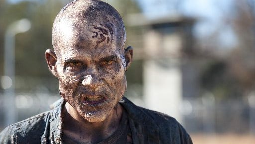 "A zombie, or ""walker,"" from Season 3 of the AMC  series ""The Walking Dead."""
