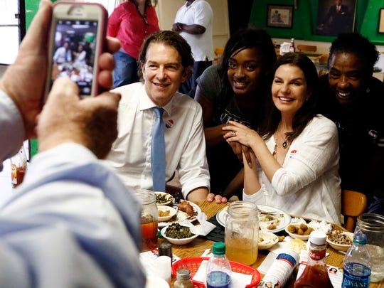 Howard Sherman, Democratic candidate for his party's nomination for the U.S. Senate seat held by Republican U.S. Sen. Roger Wicker, and his wife, actress Sela Ward, pose with a couple of employees at Gloria's Family Restaurant in Jackson, Miss., during a campaign working lunch on June 5, 2018.
