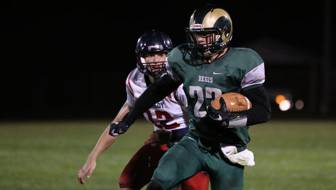 Regis's Eric Gustin runs the ball as the Rams defeat Kennedy 15-7 in a Tri-River Conference game on Friday, Sept. 30, 2016, in Stayton.