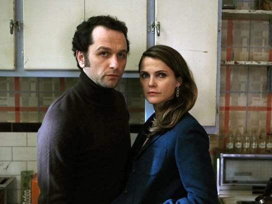 "Matthew Rhys and Keri Russell in a scene from ""The"