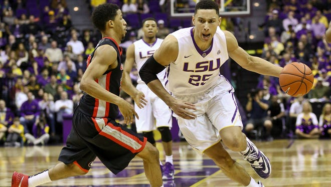 LSU forward Ben Simmons (25) drives past Georgia guard J.J. Frazier (30) during Tuesday's game in Baton Rouge.
