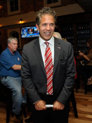 Republican candidate Mike Bishop smiles as supporters celebrate his early results success at his election night party at Brewery Becker in Brighton.