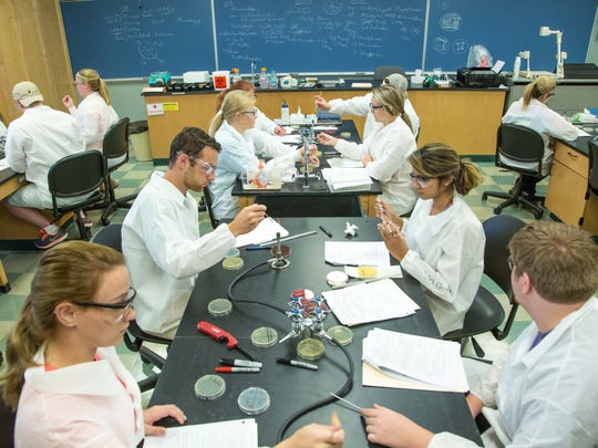 Joseph Dolan leads a microbiology class inside the