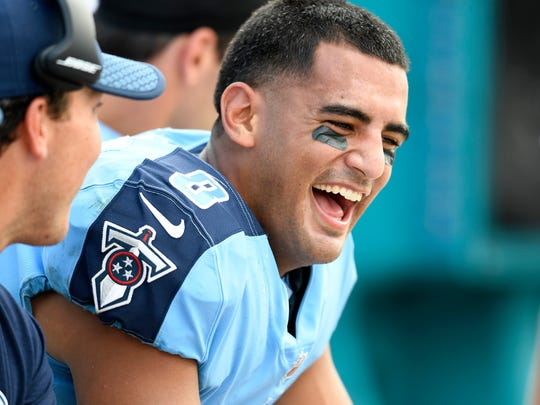 Tennessee Titans quarterback Marcus Mariota (8) enjoys a laugh as they lead the Jaguars 30-3 in the fourth quarter at EverBank Field Sunday, Sept. 17, 2017 in Jacksonville , Fl.