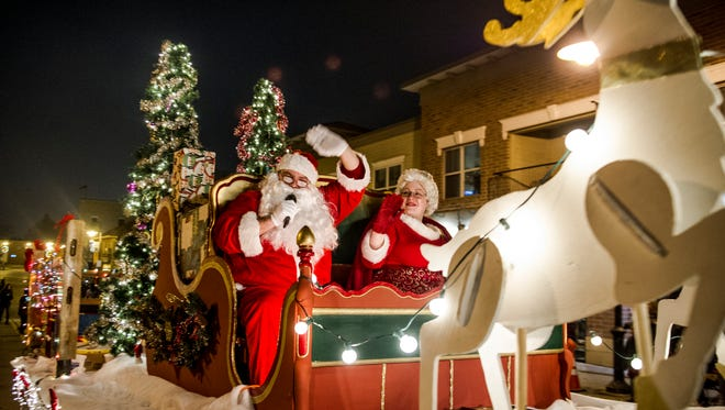 Santa and Mrs. Claus wave at a past Menomonee Falls Christmas Parade. This year's event is set for Sunday, Oct. 26.
