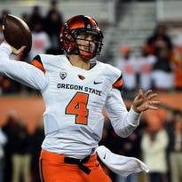 CORVALLIS, OR - NOVEMBER 29: Quarterback Sean Mannion #4 of the Oregon State Beavers passes the ball during the fourth quarter of the game against the Oregon Ducks at Reser Stadium on November 29, 2014 in Corvallis, Oregon. (Photo by Steve Dykes/Getty Images)