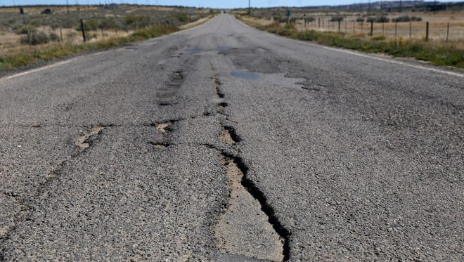 State workers have been dispatched to fill potholes on N.M. Highway 574 this week between La Plata and Aztec.