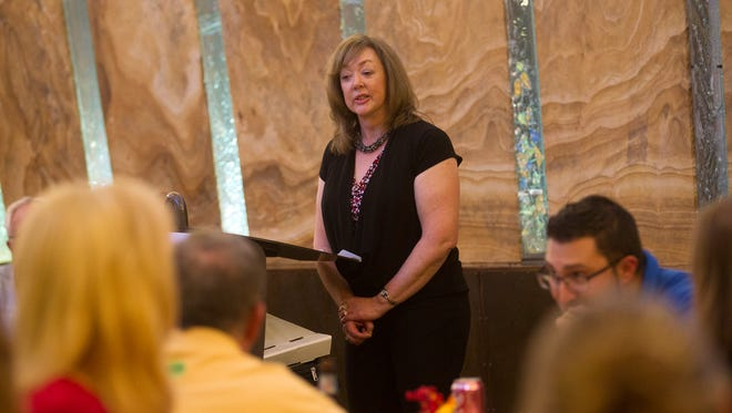 New Mexico Business Coalition President Carla Sonntag speaks Thursday during a gathering of local members at Merrion Oil and Gas in Farmington.