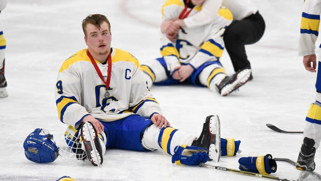 Cathedral players react to their 3-2 loss to Alexandria during the second overtime of the Section 6A hockey finals at the MAC in St. Cloud.
