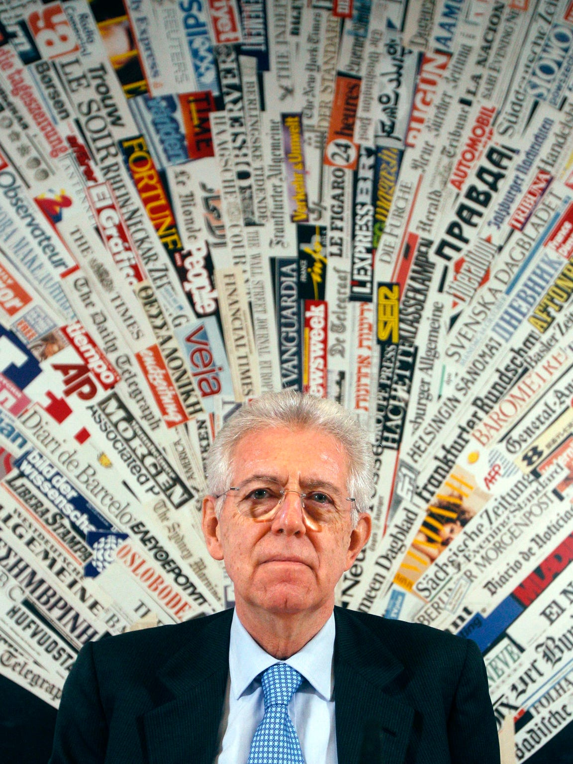 Italian Premier Mario Monti pauses as he speaks at