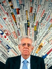 Italian Premier Mario Monti pauses as he speaks at Rome's Foreign Press Club, Dec. 5, 2011.