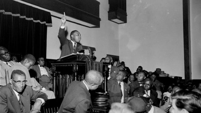 The Rev. Martin Luther King Jr. points skyward as he speaks at a mass meeting at Holt Street Baptist Church in Montgomery, Ala., during the Montgomery Bus Boycott.  (Advertiser file)