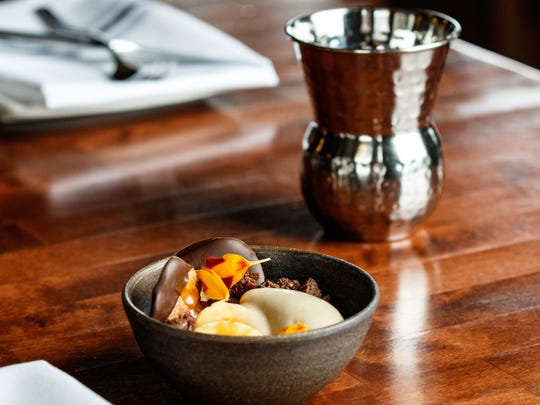 The butterscotch pot at Id features chocolate, peanut butter, banana and potato chips dipped in chocolate.