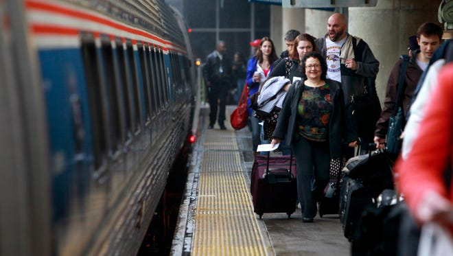 Passengers prepare to board a New York City bound train at Union Station in Washington, on Nov. 25, 2009.