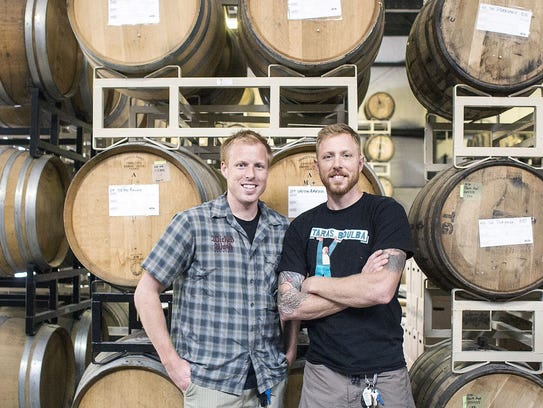 Nick, left, and Walt Dickinson, owners and brewers