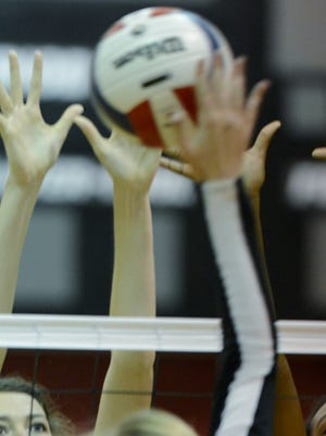MA's Lillian Roth, left, (14) and Jillian Tinglin (13) defend against PCA's Bailey Mount (3) during their volleyball game at Montgomery Academy on Monday, Oct. 21, 2013, in Montgomery, Ala., (Montgomery Advertiser, Lloyd Gallman)