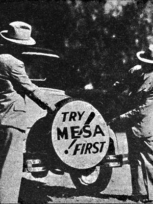 In the midst of the Great Depression, Mesa Journal-Tribune publisher Charles Mitten (l), with Chamber of Commerce Secretary William Menhennet showed off the inauguration of their Try Mesa First! marketing campaign displayed on a spare tire cover.