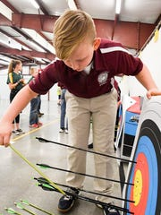 South Middle School archer Andrew Bird pulls his arrows